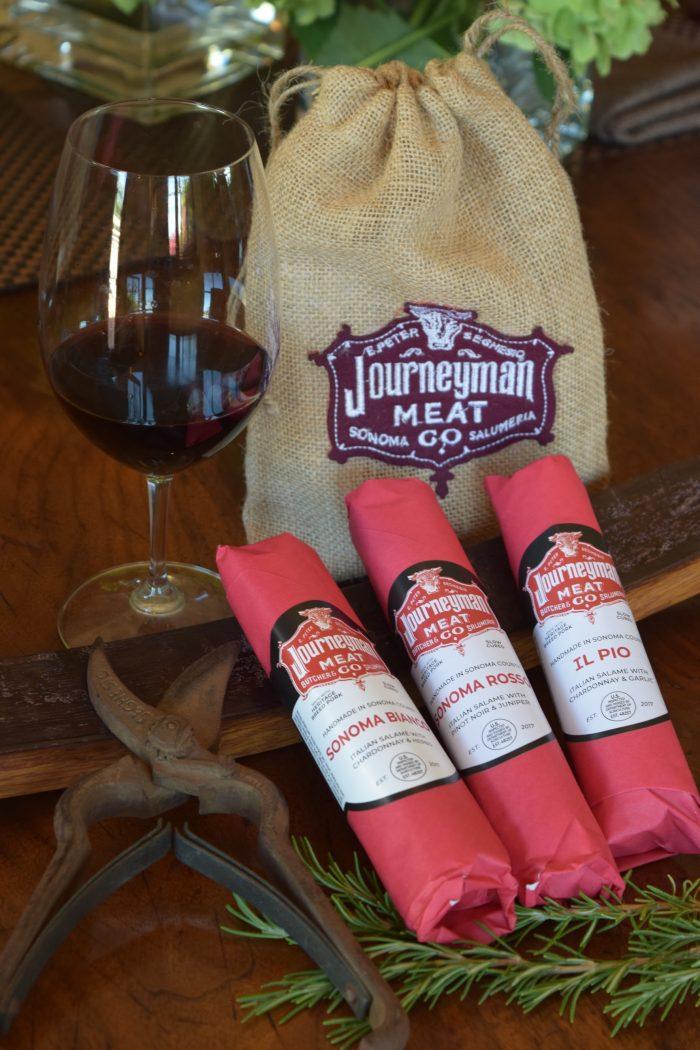 three wine friendly salumi in a logo gift bag